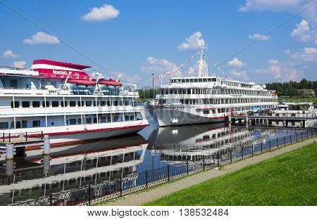 UGLICH, RUSSIA - JULY 03, 2016: Two cruise ships Konstantin Fedin and Viking Akun are at the pier of Uglich. Uglich is a historic town in Yaroslavl Oblast, Russia, which stands on the Volga River.