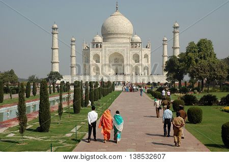 Agra, Utta Pradesh, India - march 07, 2006: General view of the gardens and people walking in the grounds of the Taj Mahal