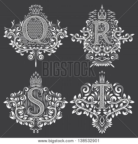 Set of heraldic monograms in coats of arms form. White floral decorative stamps on black. Isolated tattoo labels in vintage baroque style.