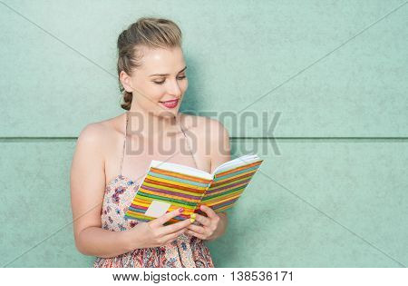 Attractive Girl Holding Diary Or Agenda And Reading