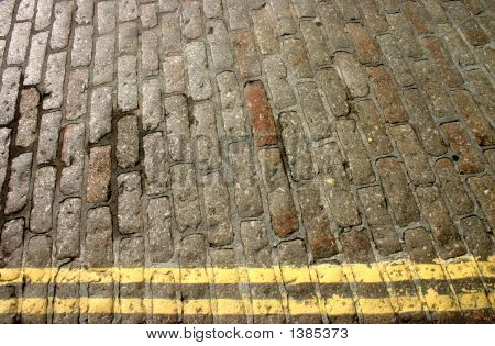 Oblong Cobblestones And Yellow Lines