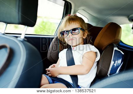 cute little girl in the car seat