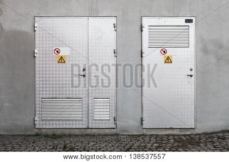 Metal Doors With High Voltage Warning Signs