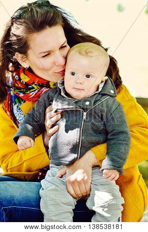mother and baby son outdoors focus on mother's face