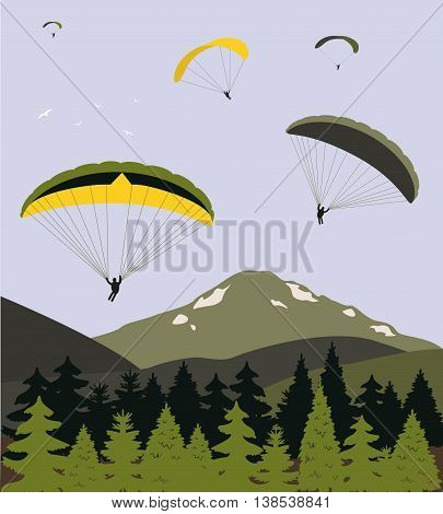 Para gliders over the mountains in bright colors