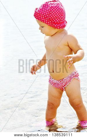 Baby Girl In Sea Water