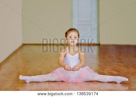 Toddler Girl Sitting In Cross Split