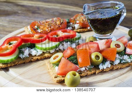 Crispbread with tomatoes cheese black olives dill. Bruschetta.