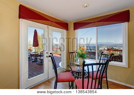 Cozy Red And Yellow Dining Area With Table Set.