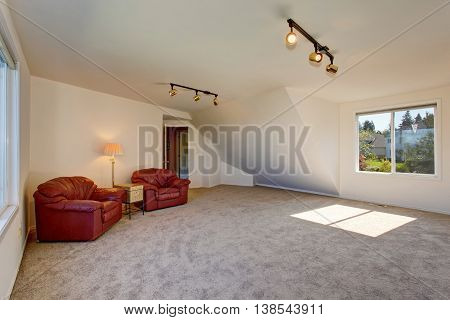 Bright Spacious Sitting Area Upstairs With Vaulted Ceiling.