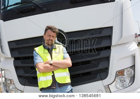 Proud Driver Or Forwarder In Front Of Trucks And Trailers