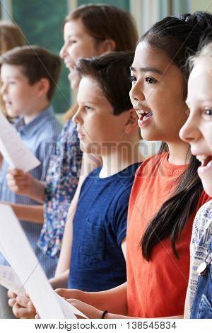 Group Of Happy Children Enjoying Singing Group