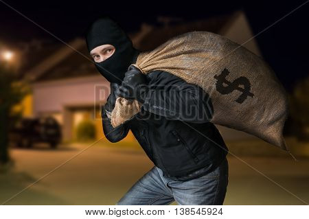 Robber Is Running Away And Carying Full Bag Of Money At Night.