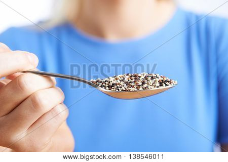 Close Up Of Woman With Quinoa On Spoon