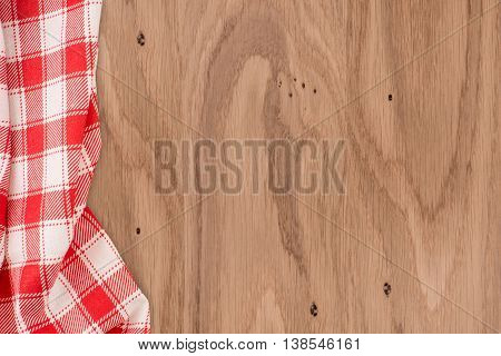 the checkered tablecloth on wooden table. the checkered tablecloth on wooden table