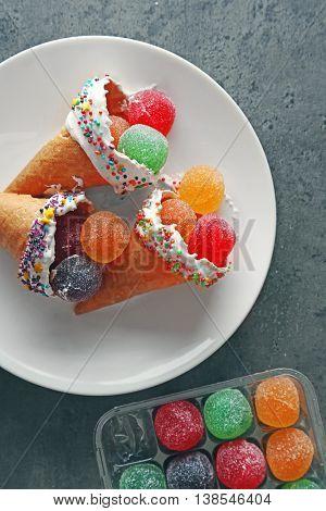 Dessert in ice cream cone on white plate