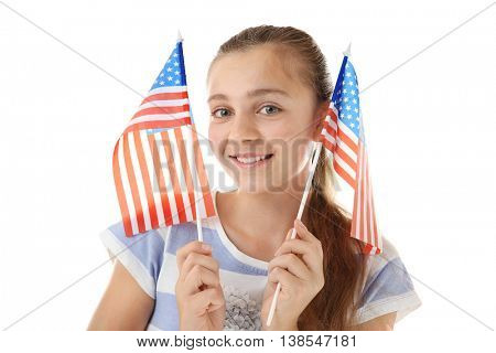 Teenage girl and American flags on white background