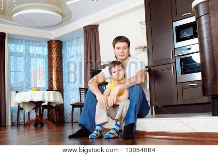 Happy father with his son at home.