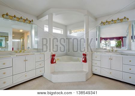 Luxury Large White Master Bathroom Cabinets With Double Sinks And Big Bath Tub.