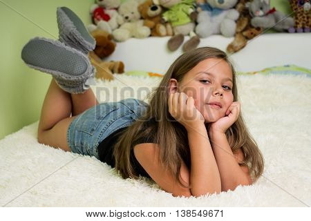 Cute Little Girl Laying On The Bed