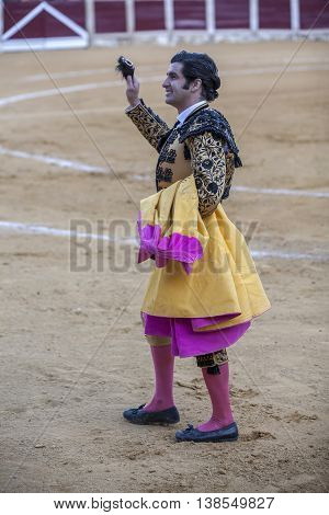 Ubeda Spain - September 29 2010: The Spanish Bullfighter Morante de la Puebla greeting the public with its cap in the hand in gratitude to its bullfight in the Bullring of Ubeda Spain
