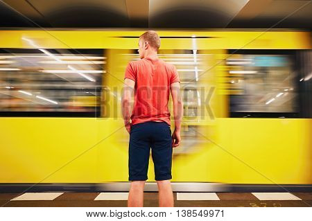 Traffic in subway. Young man is waiting for subway. Berlin Germany