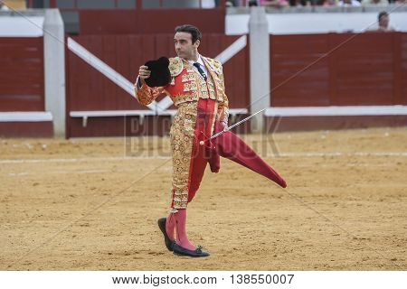 Pozoblanco Spain - September 23 2011: The Spanish Bullfighter Enrique Ponce greeting the public with its cap in the hand in gratitude to its bullfight in the Bullring of Pozoblanco Spain