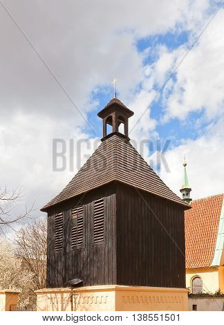 PRAGUE CZECH REPUBLIC - MARCH 29 2016: Unusual black bell tower (1482) of Church of Saint Michael in Podoli district of Prague. Church was founded in 13th c. and is one of oldest in Prague
