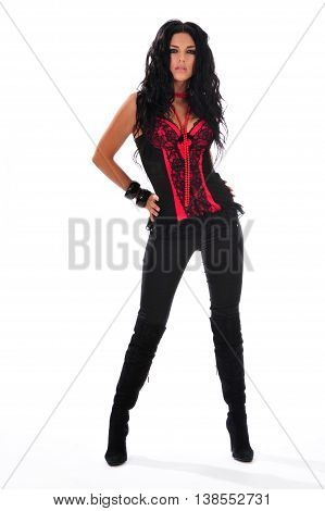 Sexy woman in red corset posing on white background