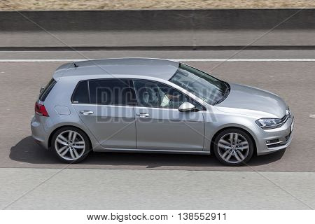 FRANKFURT GERMANY - JULY 12 2016: Volkswagen Golf compact car driving on the highway in Germany