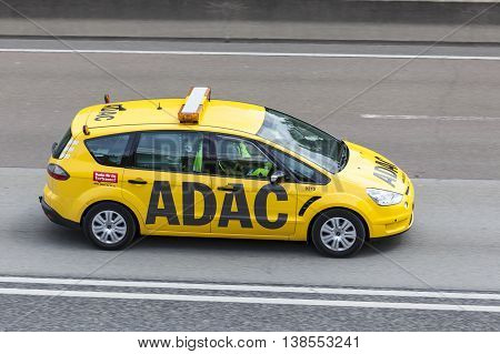 FRANKFURT GERMANY - JULY 12 2016: Yellow ADAC Ford S-Max on the highway. The ADAC (Allgemeiner Deutscher Automobil-Club) is an automobile club in Germany
