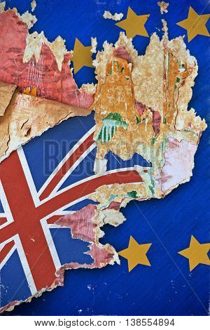 Grunge paper with UK flag on the wallpaper break away from the European Union. Concept Brexit. Old grunge tattered wall cover in a ruined house.