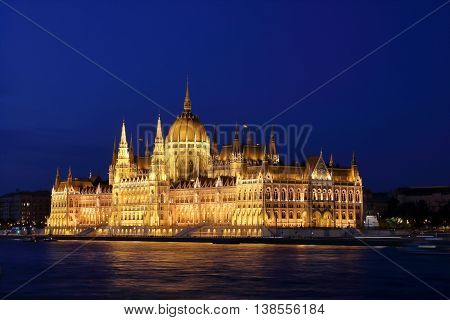 Night scene of Hungarian Parliament Building at the Danube River bank viewed from the Chain Bridge Budapest