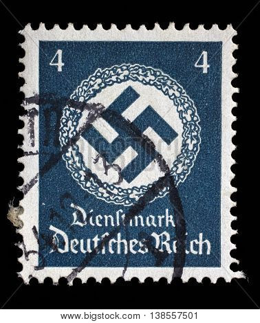 ZAGREB, CROATIA - JUNE 22: A postage stamp printed in Germany shows the Swastika in an oak wreath, circa 1942, on June 22, 2014, Zagreb, Croatia