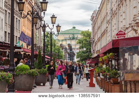 SAINT PETERSBURG, RUSSIA -JULY 09, 2016: Tourists walk on pedestrian street in the center of St. Petersburg on Malaya Sadovaya, many street cafes