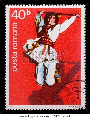 ZAGREB, CROATIA - JULY 19: A stamp printed by Romania, shows Romanian male folk dancer, circa 1977, on July 19, 2012, Zagreb, Croatia