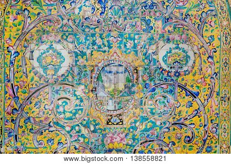 TEHRAN, IRAN - OCTOBER 6, 2014: Vintage colorful ceramic tile wall of the royal Golestan Palace on October 6, 2014. Golestan Palace was rebuilt in 1865. UNESCO World Heritage site