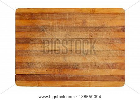 top view of a heavily used wood kitchen cutting board isolated on white background