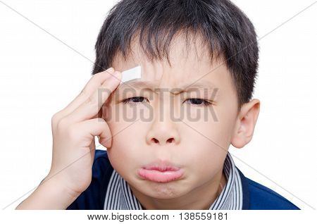 Asian boy with wound on head cover by plaster over white background
