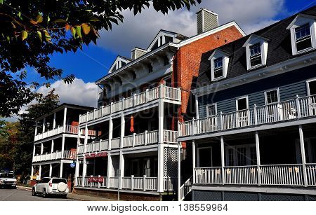 Cold Spring NY - October 17 2014: The 19th century Hudson House River Inn (right) with two other handsome West Street buildings with their distinctive white wooden porches *