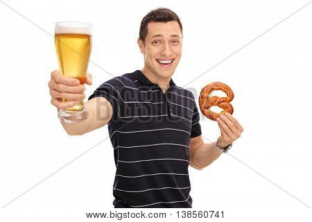 Cheerful guy holding a pretzel and a pint of beer isolated on white background