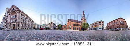 RIGA, LATVIA - JULY 10, 2016: 360 degree panoramic Skyline view of Riga old town Dome Square During Dawn time. Montage from 47 HDR images