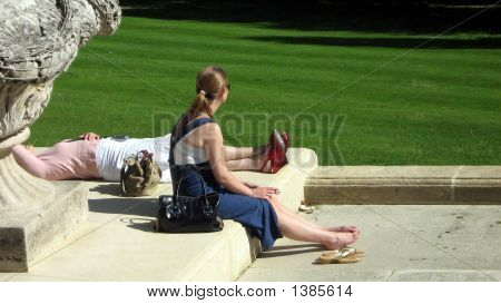 Women Smoking And Sitting/Laying In The Sun.Holiday.