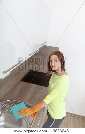 Young Woman Cleans And Cleans The Kitchen.