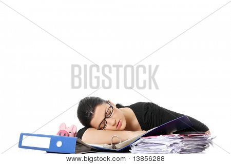 Exhausted female filling out tax forms while sitting at her desk.  Isolated on white