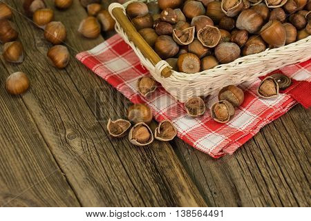 Hazelnuts in small wicker basket. Hazelnuts in small wicker basket.