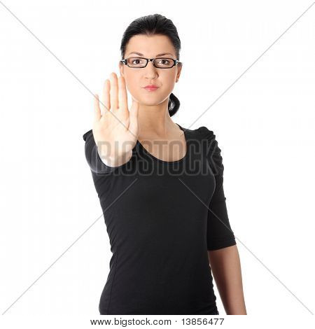 Hold on, Stop gesture showed by young woman hand. Isolated on white