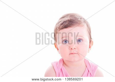 Image of a beautiful serious baby girl.