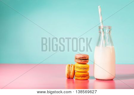 Stack Of Macarons With Botle Of Milk