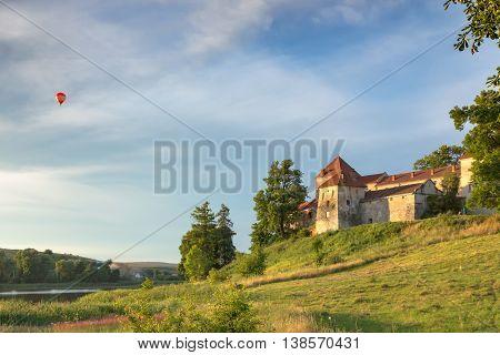 Summer evening view of old castle in Svirzh, Ukraine